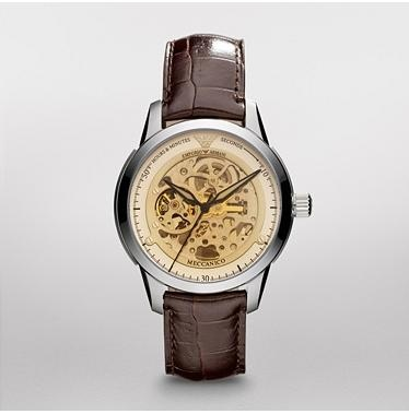 Meccanico Watch       $276.50  SALE Original Price - $395Fashion meets function with this automatic watch from Emporio Armani. The stainless steel case features an amber crystal that shows the inner workings of the watch. The brown croco-embossed leather strap adds the finishing touch and ensures a comfortable fit.