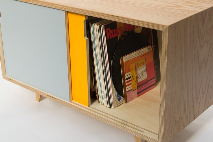Higgs Record Cabinet.  With two sliding doors and an internal divider, it works perfectly as a media unit with optional shelves and cable routing. Made from Baltic Birch plywood with oak veneer, it is then finished in hard wax oil to provide resistance against stains and wear. Various Formica door options are available on request.