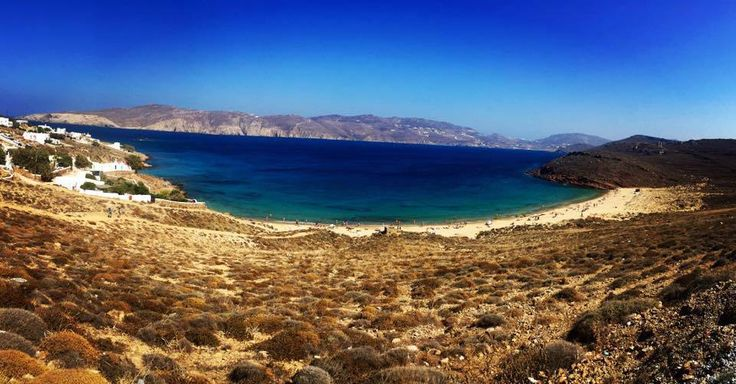 Agios Sostis Beach The water is a deep blue, making a beautiful contrast from the clear turquoise along the shore