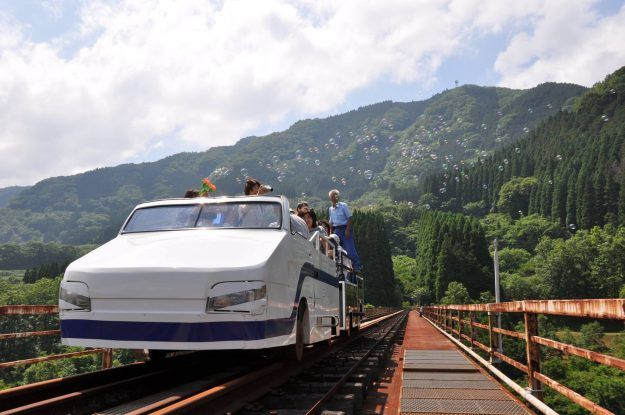 The train ride offers stunning views of the surrounding Takachiho valley.