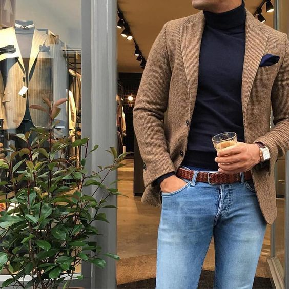 This combination of a brown wool blazer and light blue slim jeans is perfect for a night out or smart-casual occasions. Shop this look on Lookastic: https://lookastic.com/men/looks/blazer-turtleneck-skinny-jeans/23436 — Navy Turtleneck — Navy Pocket Square — Brown Wool Blazer — Brown Leather Watch — Brown Woven Leather Belt — Light Blue Skinny Jeans
