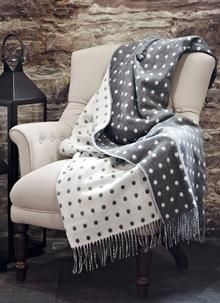 Add a layer of texture and warmth to your home this season with our lambswool spot Irish throw. Crafted with exceptional softness and quality, it is perfect to wrap up in for a relaxing and indulgent evening. 100% Lambswool 57'' X 70'' (including fringe)