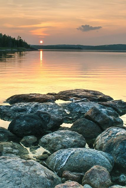 sunset, calm waters, stones