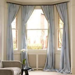 Bay Window Curtain Ideas (Link doesn't link to article anymore, but there's still good articles here)