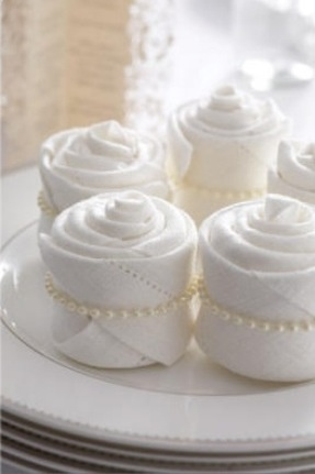 White rose bud serviettes with pearl cord give an elegant finish to any setting #napkin #entertaining