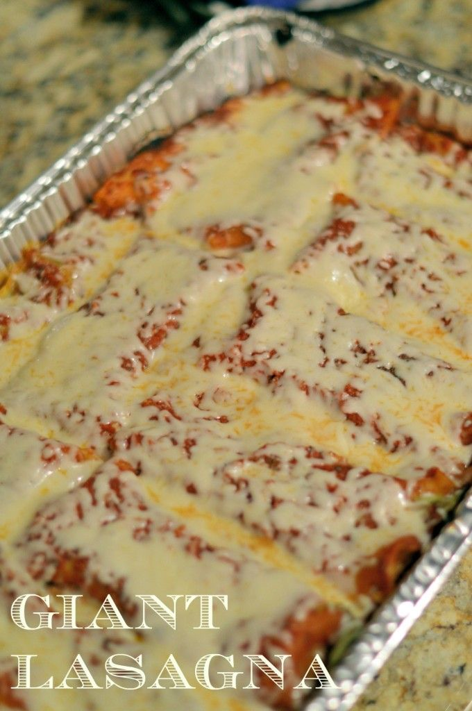 GIANT Lasagna- feeding a crowd?  This lasagna recipe will feed up to 16 people, layered with ricotta, spinach, tomatoes, onions, turkey sausage and of course, CHEESE! | #lasagna | www.savoryexperiments.com