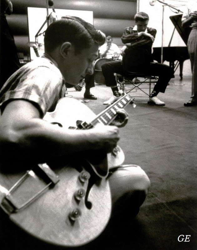 Scotty Moore at a recording session in New York, July, 1956 (Elvis sitting in the background).