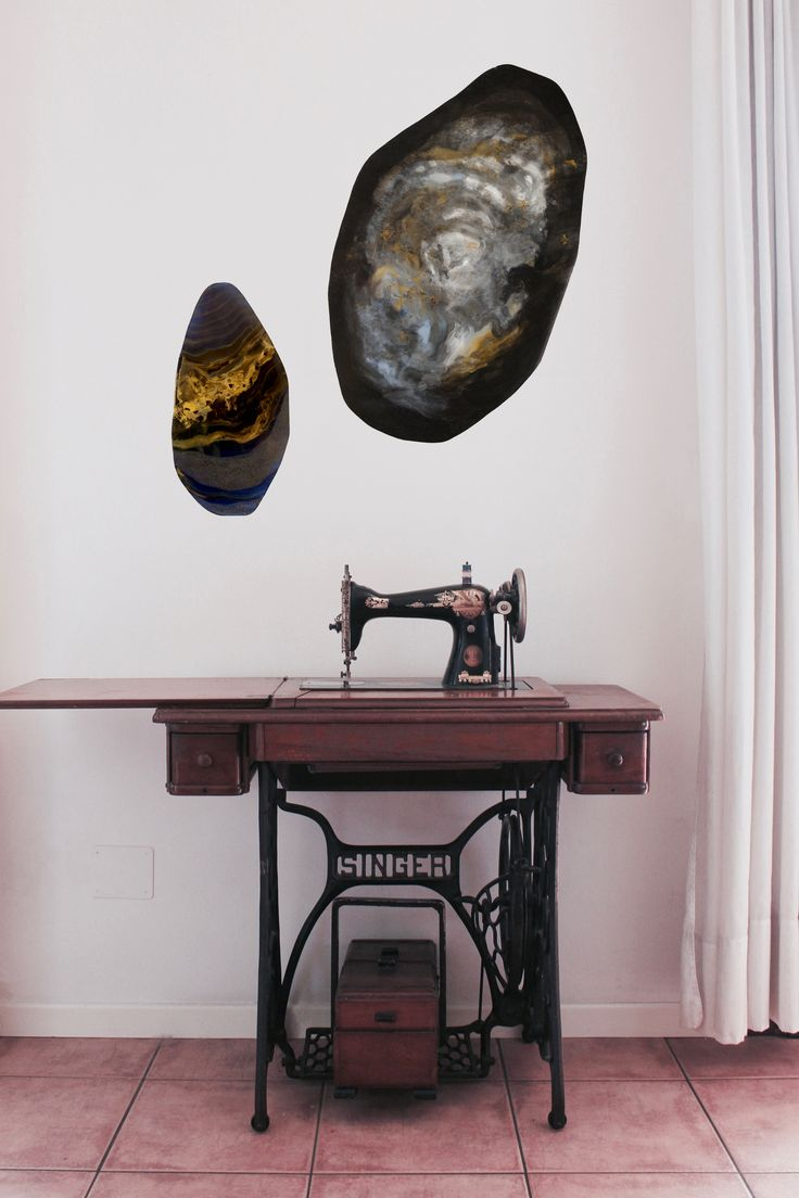 Two plexiglass sheets of a large production of mine; on the wall, they frame an old Singer sewing machine - Serena Mabilia