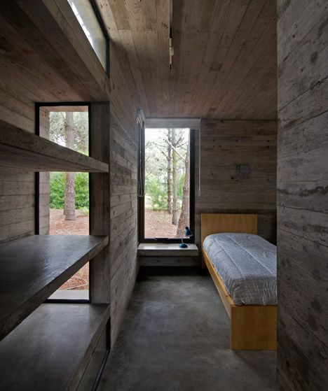 This rural Argentinian home by Luciano Kruk Arquitectos was built from intersecting slabs of timber-imprinted concrete and sheets of glass