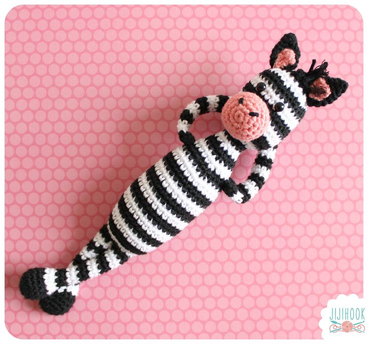 This cute zebra is called Hugo. He loves flowers, especially poppies, and above all he likes having fun…Be careful though because despite a look of contrived innocence, he loves stealing yarn balls and he hides them so well that people never find them.  Crochetted with cotton yarn (2mm hook) and filled up with synthetic fiberfill, he is around 23 cm tall (legs included). A smaller or bigger version can be made following the same pattern, simply by changing the yarn and hook size.  This is…