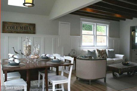 crazy for the exposed wood beams and paneling done right in this eat living/dining combo off the kitchen.