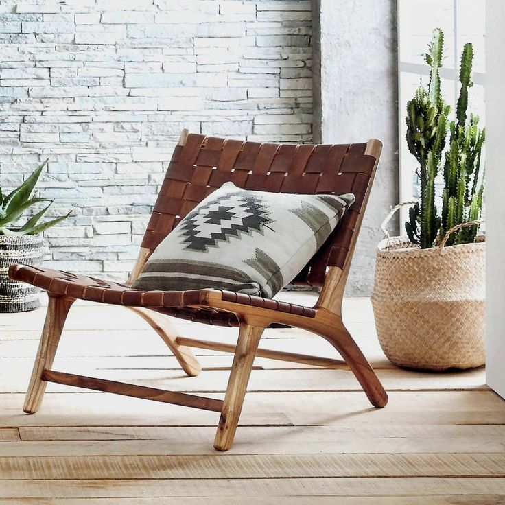 Available for Pre-Order | Ships out March 1. Place your order now to reserve your Chair! Our low, woven leather chair makes lounging an inescapable temptation. Leather straps in a rich caramel color a