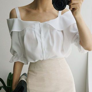Shoulder straps create sharp angles while also holding up this breezy blouse styled with a wide collar that sits at the bust line. Full-length button placket, gathered sleeves and pleats add a sweet finish.