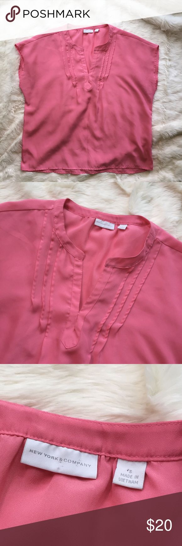 """NY & Co tunic pink top blouse batwing shirt Pink, loose-fit top, by New York and Company. Color is a true pink, not pastel and not hot pink, I consider it a bubblegum color. Shirt is a tunic style, with capped/batwing sleeves. Excellent, gently used condition. Note- the color in photos on my iPhone 6 is a lot brighter than the true color. On my iPad mini, the color is exact. Please know colors vary from screen to screen.   Approximate measurements:  23.5"""" across bust  23"""" total length New…"""