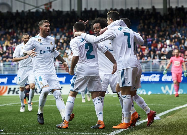 Cristiano Ronaldo Photos - Cristiano Ronaldo of Real Madrid celebrates after scoring his team's second goal during the La Liga match between SD Eibar and Real Madrid at Ipurua Municipal Stadium on March 10, 2018 in Eibar, Spain . - Eibar v Real Madrid - La Liga