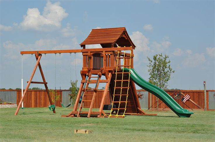 """Redwood FORT RANGER Made in the USA!  Features:  7' Deck (4x6 Angled Legs) 14' Rocket Slide Tire Swivel Swing Wooden Roof 3 Position Swing Beam (2) Belt Swings Trapeze Bar Rock Climbing Wall Wooden Flat Step Access Ladder Approx. DECK Dimensions: 61"""" x 80"""""""