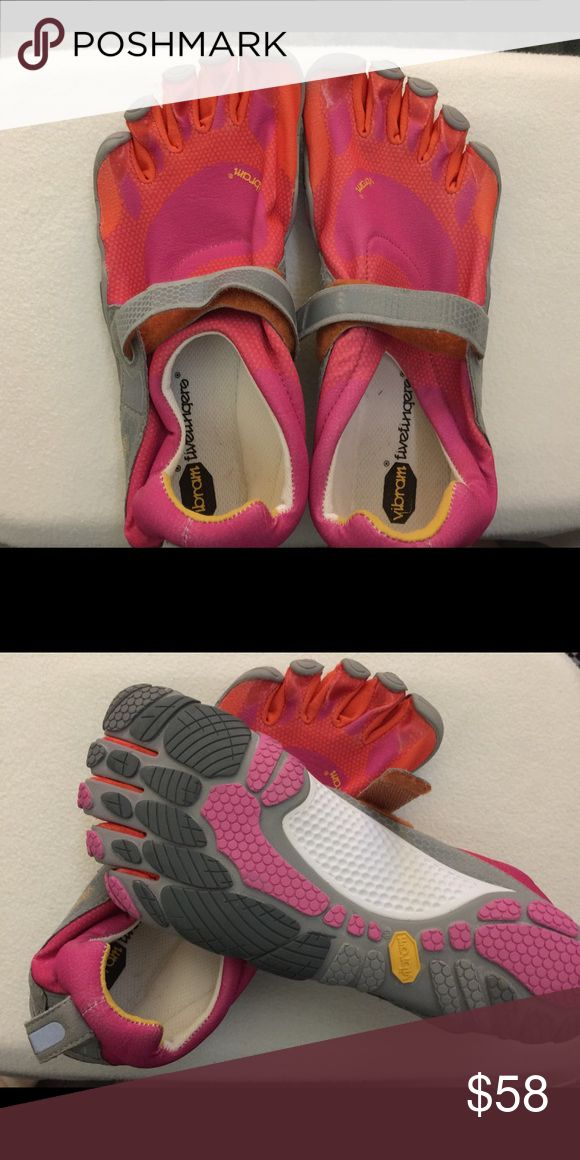 Vibram 5 finger toe shoes Vibram toe shoes new w/o tags tried in but never actually worn outside. Great barefoot running shoes. Pink and orange with sizeing Velcro strap. Vibram Shoes Sneakers