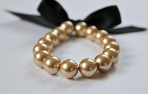 https://www.etsy.com/fr/listing/168317124/bracelet-ruban-de-perle-or-et-noir?ref=shop_home_active_20