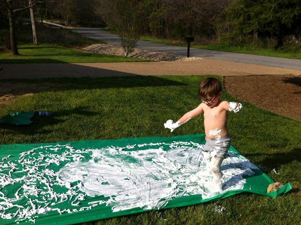 Shaving Cream Slip-N-Slide: 25 DIY Summer Activities For Kids | What The Flicka? #craft #ideas