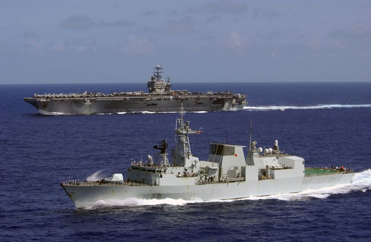 HMCS Vancouver (FFH 331) with USN carrier.