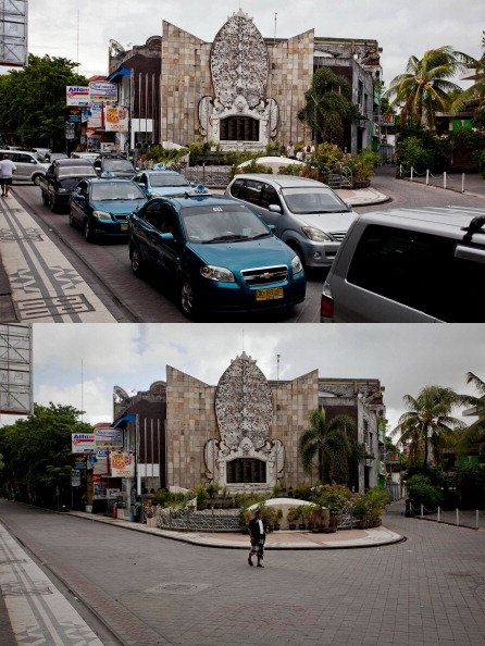 """In this composite image an active Monument Bali Bombing """"Ground Zero"""" area is seen on March 9, 2013 and bottom, the same street is seen on Nyepi day on March 12, 2013 in Denpasar, Bali, Indonesia. Nyepi means 'Day of Silence'"""