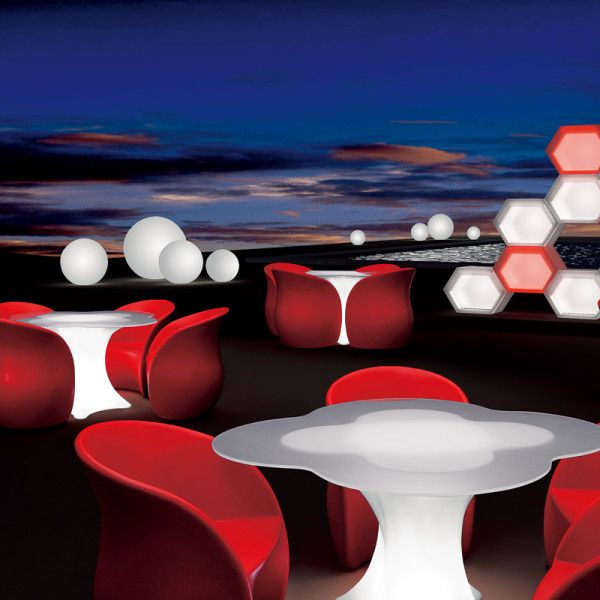 Petalo Outdoor Illuminated Dining Table. With its interchangeable and remote controlled LED light inside, you can take it anywhere you want. No electrical cables, no mess, no fuss.