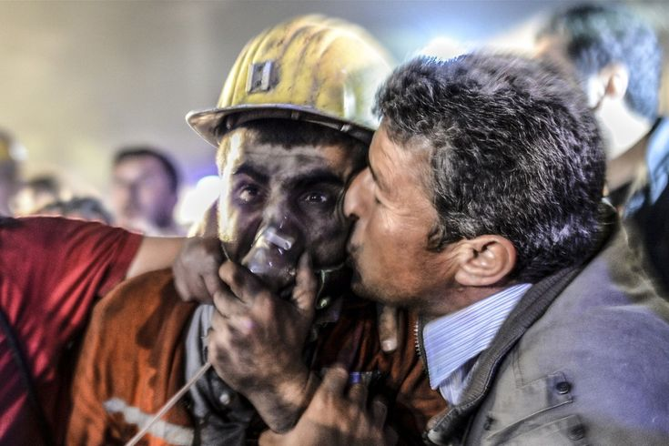 Week of May 10-16, 2014 A man kisses his son, rescued from a collapsed coal mine, on Tuesday after a mine explosion in Manisa, Turkey. At least 157 miners were killed in the collapse. Bulent Kilic/Agence France-Presse/Getty Images