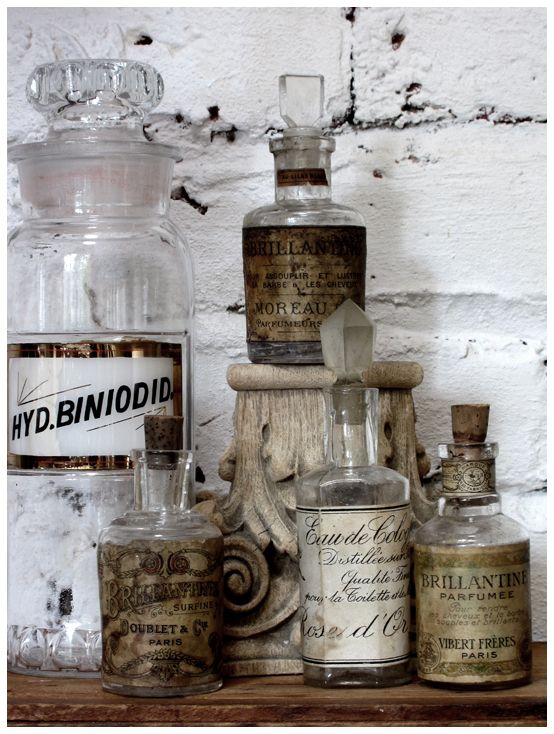 Antique apothecary bottles give a wonderful vintage feeling. Use them as floral holders or wash them and use them to hold various drink mixers.