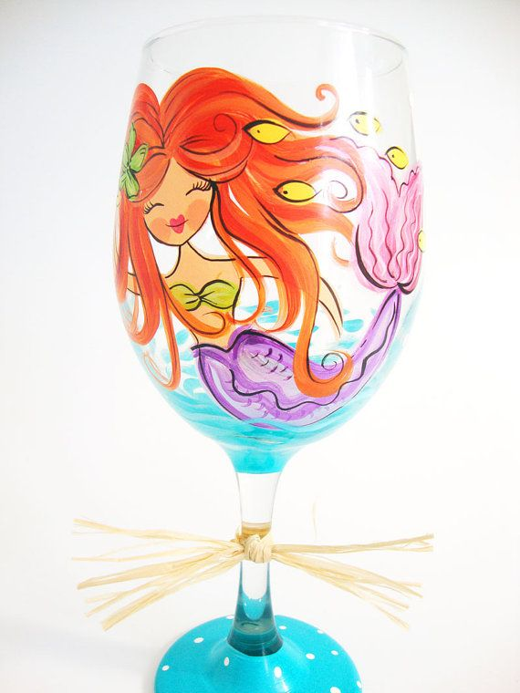 A hand painted mermaid wine glass for your little drinky