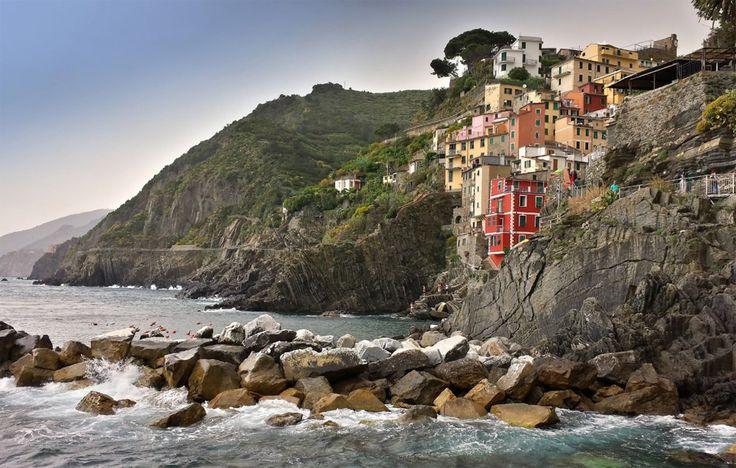 a village on cliff, riomaggiore, italy