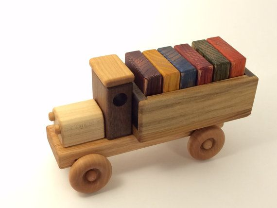 This handmade truck is just waiting for a young child with busy hands to play with it. Along with its six wooden building blocks for fun and interaction, it is sure to put a smile on anyones face-young or old The truck is approx. 7 inches long, 3 inches wide and 4 inches high and is finished with non toxic mineral oil for safety. Each building block is 1 3/4 inches square and 1/2 inch thick and is stained with a water based, child safe stain. Wood variations may vary.  Please let me know if…