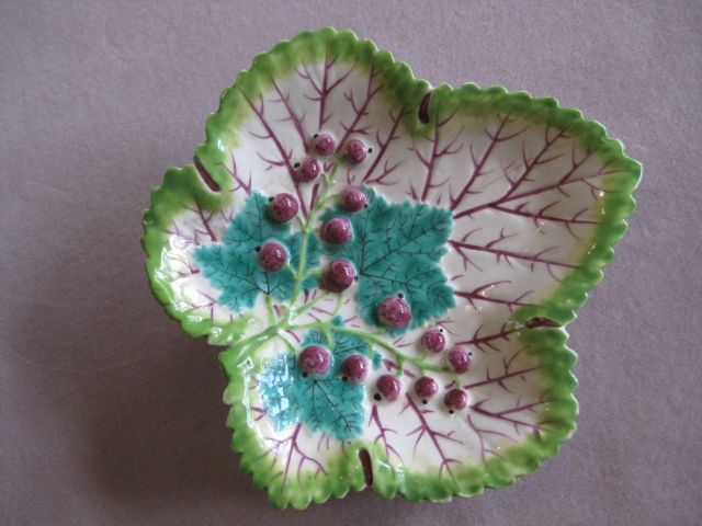"""A rare Bow  leaf shaped dish with a serrated green edge and puce veining and moulded with three turquoise leaves to the interior and sixteen  puce berries. Unmarked Circa 1760 Width 5 3/4"""""""