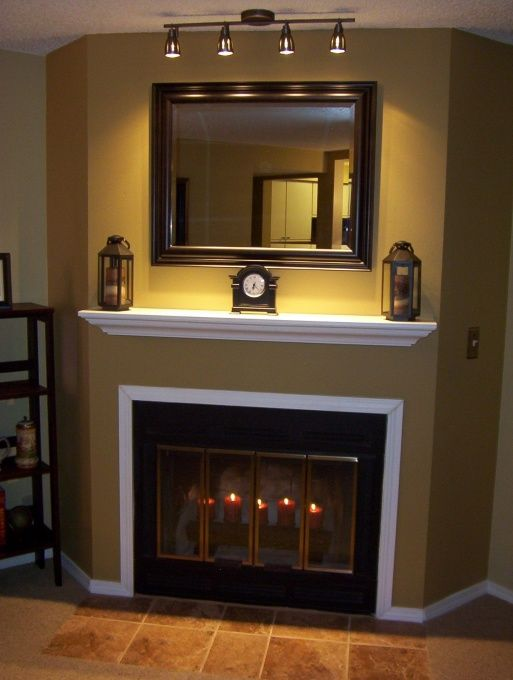 """WOW. Like the mirror and the lights over the mantel!  The color is """"Mannered Gold / SW 6130"""" by Sherwin Williams.  Fireplace before and after"""