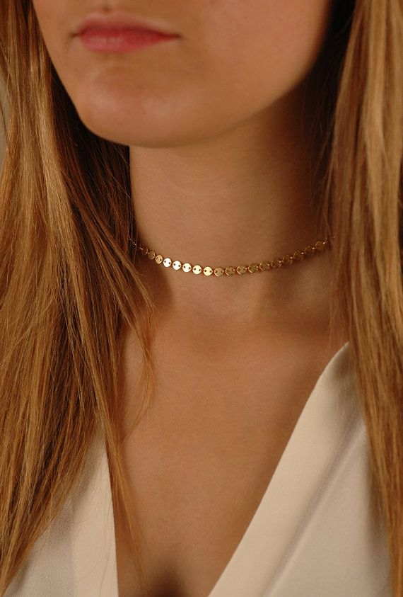 All the trend!! This very popular tattoo choker is now available in genuine Gold-Filled, Sterling Silver, or Rose Gold-Filled. This choker is made of the highest quality materials.  About the Flat Disc Necklace: - 14K Gold-Filled (shown in photo), or Sterling Silver, or 14K Rose Gold-Filled - Your choice of adjustable length from 10 - 16 (The very petite model in first photo is wearing about a 13 chain) - discs measure about 4mm wide - Beautifully Gift Boxed - Made in the USA - parts and…