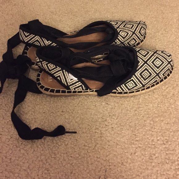 Toms espadrille sandals Black and white espadrille lace up sandals. Only worn once. TOMS Shoes Espadrilles
