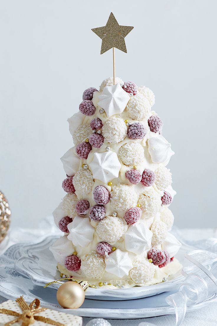Sculpt this gorgeous White Christmas tree out of vanilla ice-cream and decorate with mini meringues, frozen raspberries and little chocolates for a stunning centrepiece for your festive feast.