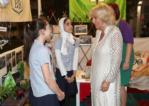 Camilla, Duchess of Cornwall speaks to young guests as she attends a reception at the British Embassy on November 10, 2016 in Manama, Bahrain.