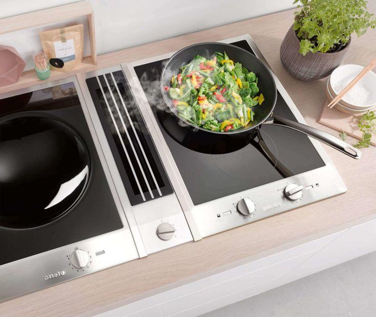 Miele Kochfeldabzug: Der Tischlüfter TwoInOne kombiniert das Kochfeld mit einem Dunstabzug nach unten
