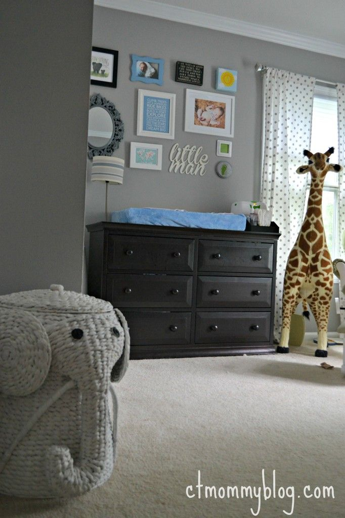 Project Nursery - Baby Boy Safari Nursery (I'm far from having kids of my own but I totally love that adorable elephant basket and large giraffe!!!!)