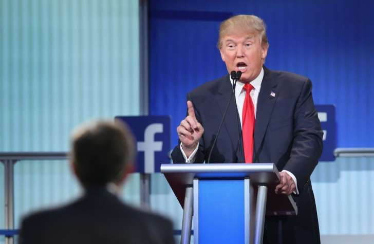 Donald Trump fields a question during the first Republican presidential debate hosted by Fox News and Facebook on Aug. 6, 2015, in Cleveland.
