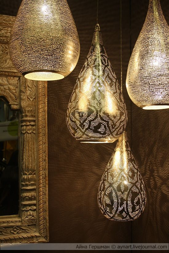 Cool metal light fixtures, Moroccan style.. I see a glass vase with faux mercury glass and charcoal stenciling..
