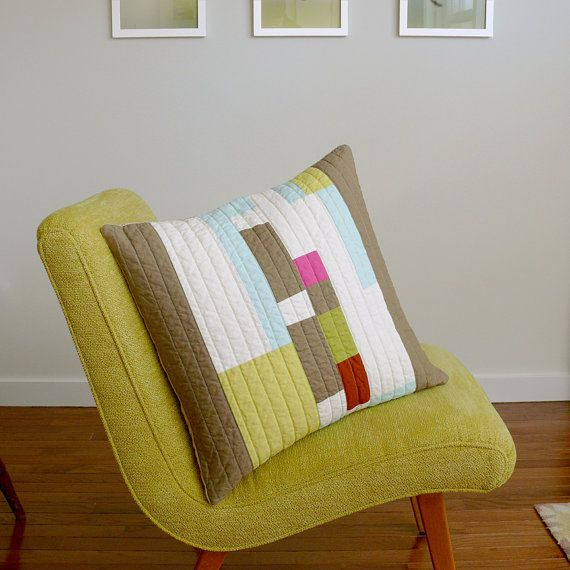 love the quilted pillow...lots of nice solid fabrics. Reminds me of one my daughter made for her bedroom... very modern.