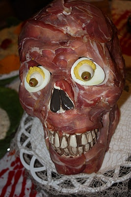 The boys might like this...prosciutto and cream cheese appetizer skull - creepy! halloween party appetizer