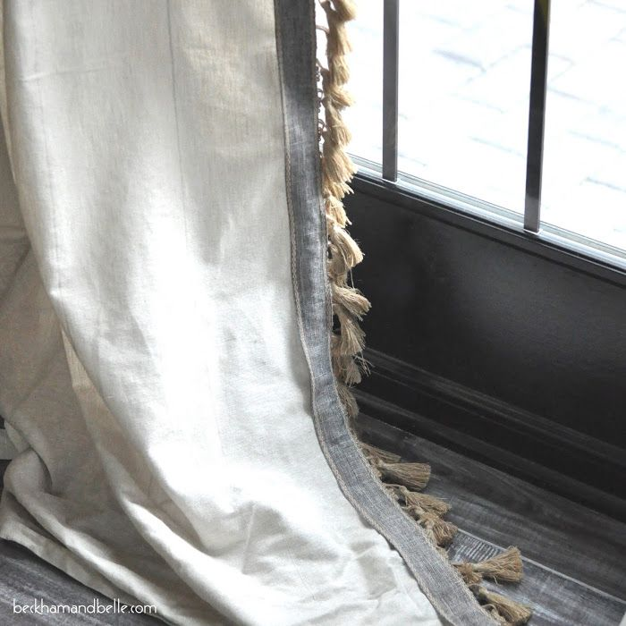Inspired by Anthropology drapes, this blogger added soft brown tassels and grey (almost silver) lining to the sides of neutral curtains to create a vintage vibe on otherwise ho hum curtains. Get the tutorial at Beckham + Belle »   - HouseBeautiful.com