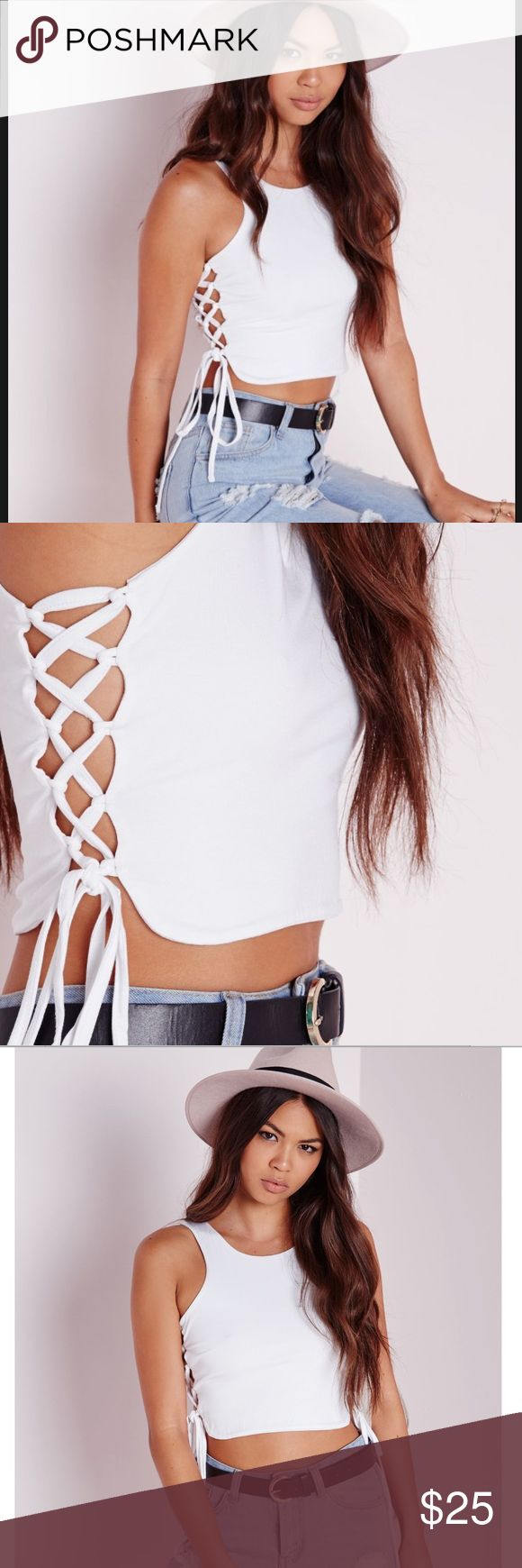 Missguided Lace Up Side Crop Top Slightly see through white fabric depending on what you wear underneath. It's still thick fabric though. And I just love the Lace up detailing on the side! Looks cute with a pair of ripped jeans 😍 I'm not sure why it says size 1 on the tag, online it said size 0 and the options were size 0 or 2! Missguided Tops