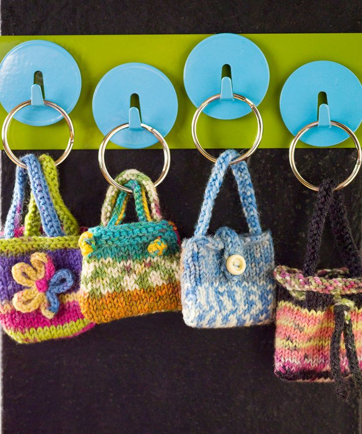 These mini knit keyring purses are awfully cute. Just make sure to knit them in some durable sock yarn containing a bit of nylon so they'll hold up in use.  Wonder if we could use these for the barbies???