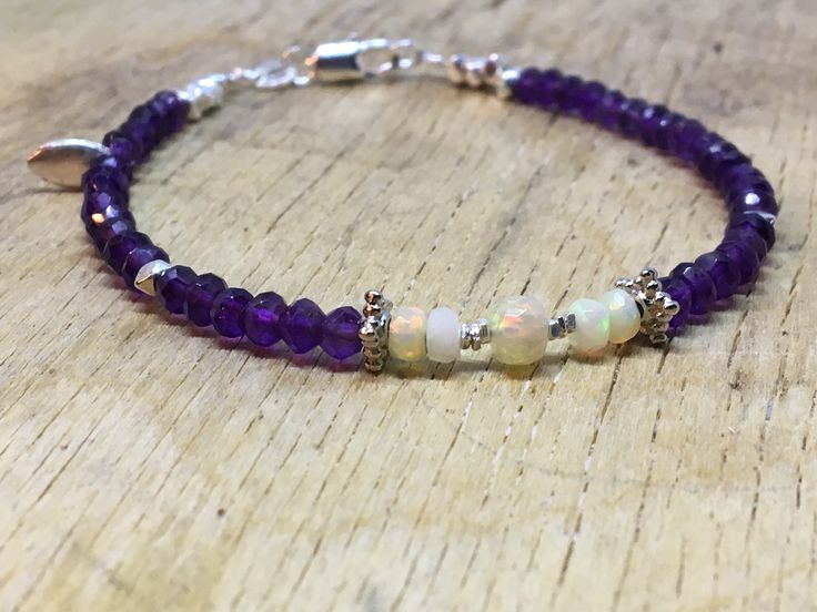 A personal favourite from my Etsy shop https://www.etsy.com/no-en/listing/560679462/amethyst-and-opal-bracelet-faceted-welo