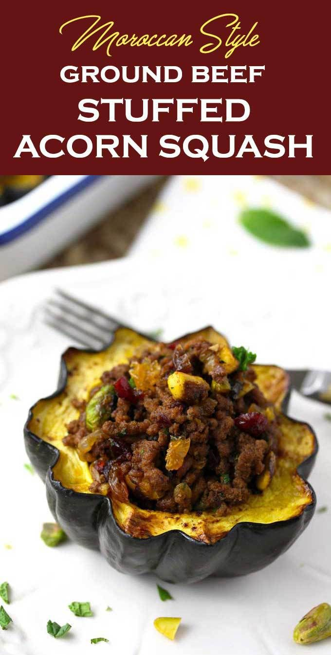 A Stuffed Acorn Squash On A White Plate Garnished With Fresh
