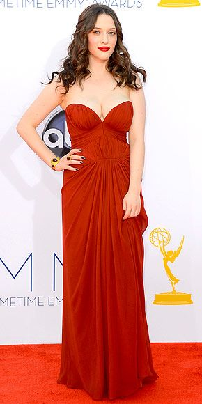 Emmys 2012: Kat Dennings in a goddess gown by J. Mendel, which featured a revealing sweetheart neckline with statement Neil Lane jewelry, loose waves, dark nails, and a bold lip.