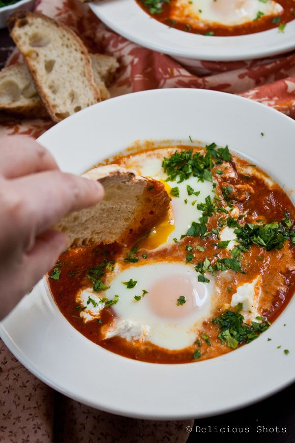 Shakshuka (Eggs cooked on top of a fresh tomato sauce with feta) - North African/Middle Eastern dish